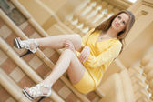 Young woman sitting on the stair — Stock Photo