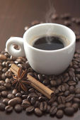 Cup of hot coffee with chinnamon and anise — Stock Photo