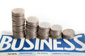 Coins diagram on the business newspaper — Stock Photo