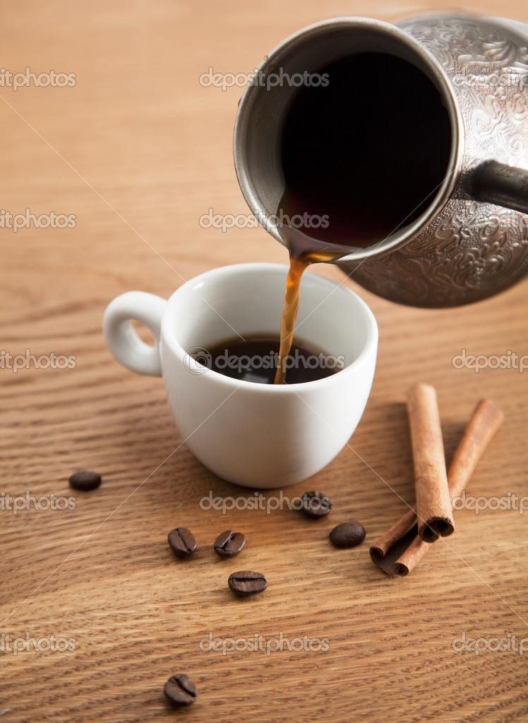 Pouring coffee into white cup — Stock Photo #10684315