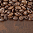 Coffee beans on the wooden background — Foto Stock
