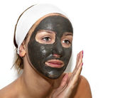 Deep sea mud mask treatment on the woman face — Stock Photo