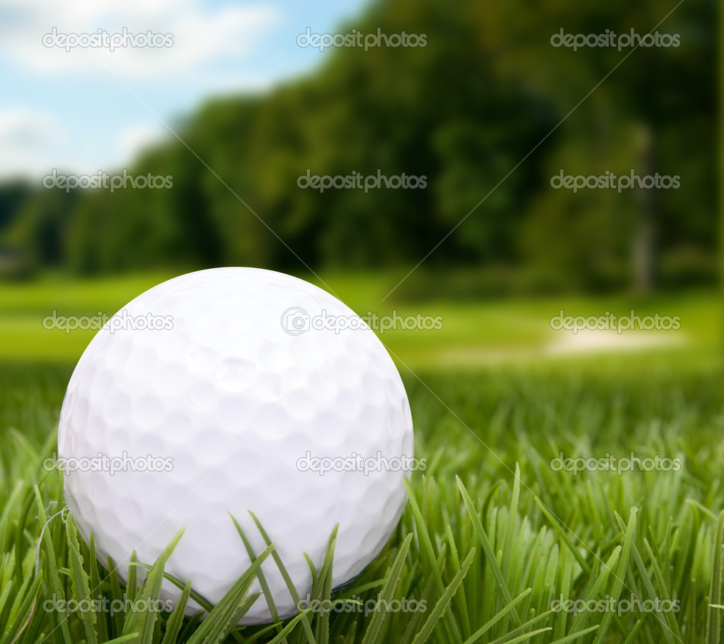 Golf Ball in Grass -  Golf Course in Background — Stock Photo #10534750