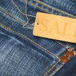 Jeans With Sale Tag - Stock Photo