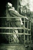 The beautiful woman near a handrail — Stock Photo