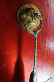 Tibetan red door — Stock Photo