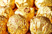 Chocolate wrapped in golden paper — Стоковое фото