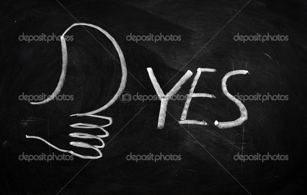 YES with a thumb sign written on blackboard  Stock Photo #8125654