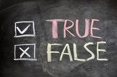 True and false check boxes written on a blackboard — Stock Photo