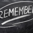 Remember word written on a blackboard — Foto Stock