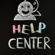 Help center with human figures drawn on blackboard — Stock Photo