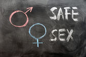Safe sex concept with gender symbols — Stock Photo