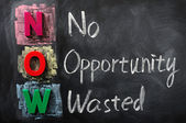 Acronym of NOW for No Opportunity Wasted — 图库照片