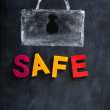 A Lock drawn in chalk with the word Safe — Stock Photo