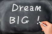 Dream big written with chalk on a blackboard background — Zdjęcie stockowe