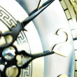 图库照片: Clock hands, shallow DOF