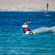 Stock Photo: Kite surfing on sea