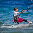 Stock Photo: Kite surfing on sea.