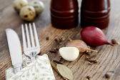 Spices, garlic and onions, fork and knife. — Stock Photo