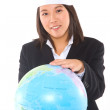 Stock Photo: Asian businesswoman with santa hat and globe