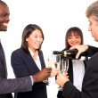 Multi-ethnic team toasting — Foto Stock