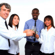 Multi-ethnic team toasting — Stock Photo #8030269