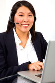 Businesswoman with headset microphone — Stock Photo