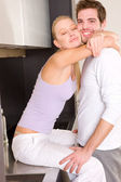 Couple at home embracing — Stock Photo