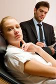 Psychiatrist examining a female patient — Stock Photo