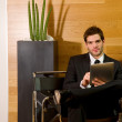 Business man waiting in office lobby — Stock Photo