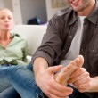Man massaging woman's feet — Stock Photo #9564447