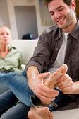 Man massaging woman's feet — Stock Photo