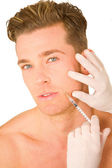 Young man doing botox injections — Stock Photo