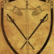 Foto Stock: Ancient Shield of Arms on Brown Crackled Surface