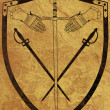 Photo: Ancient Shield of Arms on Brown Crackled Surface