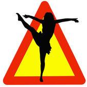 Silueta de la bailarina en señal de advertencia de tráfico — Foto de Stock