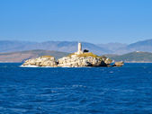 Island with a lighthouse — Stock Photo