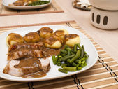 Roast pork in gravy with silesian noodles — Stock Photo