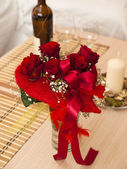 Bouquet of red roses and wine — Stock Photo