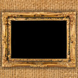 Gold frame on brown fabric background — Stock Photo