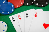 Aces and poker chips — Stock Photo