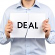 "Man holding a torn paper which says ""Deal"" — Stock Photo"