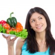 Young woman with plate of fresh healthy vegetables — Stock Photo #10106403