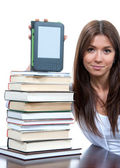 Woman with books and ebook reader — Stock Photo