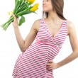Woman with yellow tulips bouquet of flowers smiling — Stock Photo #9449093