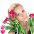 Young woman with bouquet of red tulips flowers — Stock Photo