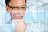 Businessman studying digital economic report — Stock Photo