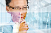 Businessman studying realtime digital financial market — Stock Photo