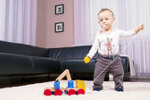 The boy in the room, playing with abandon. — Stock Photo