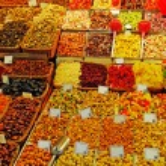 Постер, плакат: Abundance of nuts fruits sweet things at Barcelona market